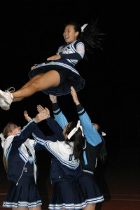Cheerleader Melissa Calica (Sr.) is secured after a lift.