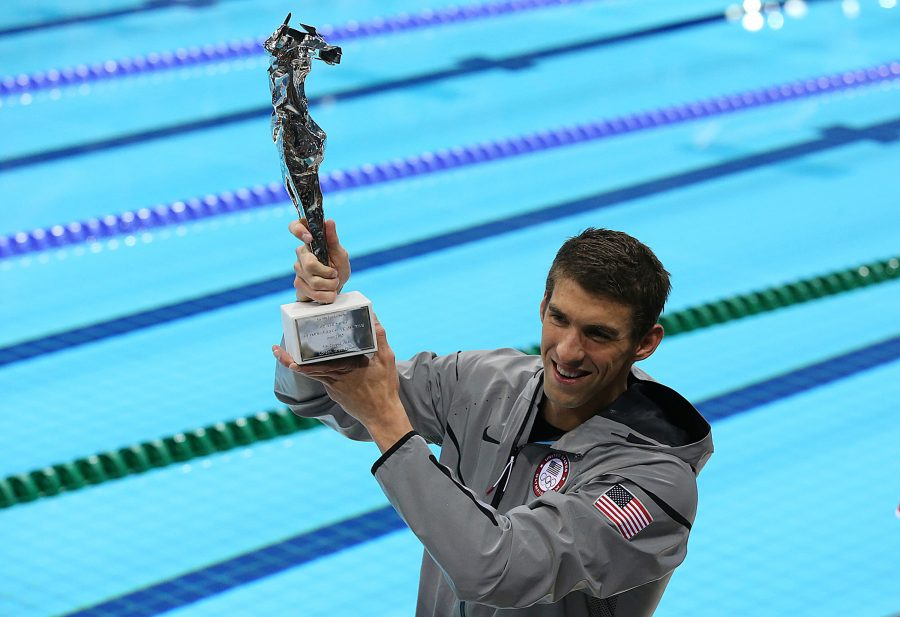 Michael Phelps shows off an award he received for becoming the most decorated Olympian in history. (Robert Gauthier/Los Angeles Times/MCT)