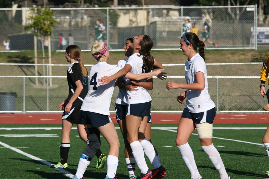 The+UHS+girls+soccer+team+celebrate+after+scoring+a+goal.