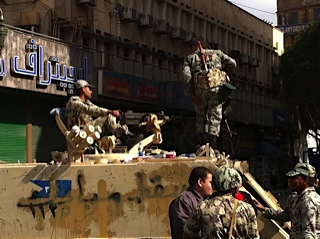 Soldiers block an entry to Tahrir Square.