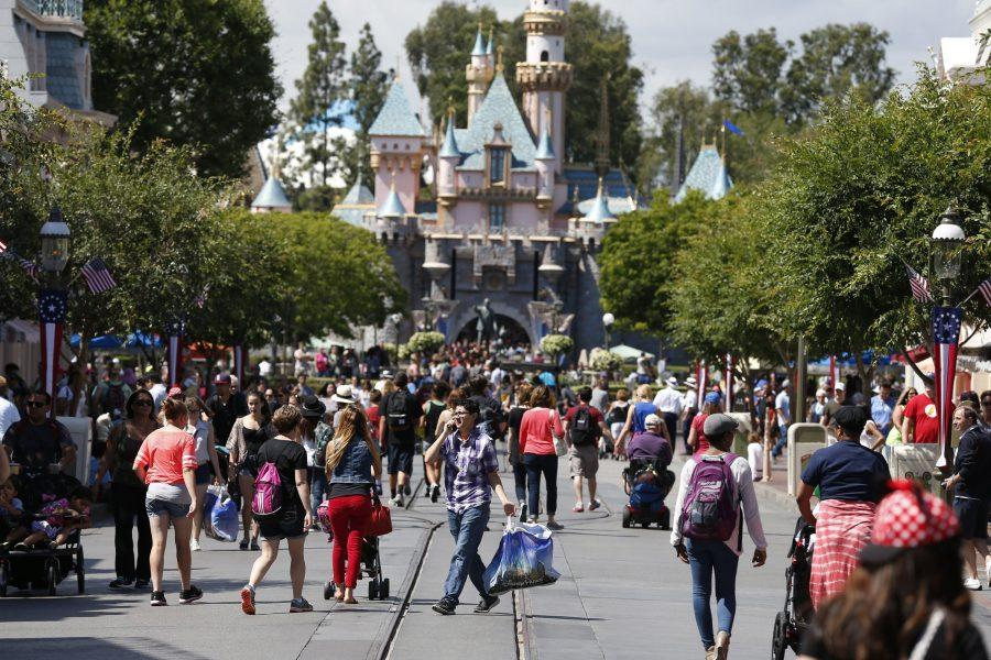 Patrons walk along Main Street in Disneyland, May 20, 2014, in Anaheim, Calif. Disneyland, which calls itself the happiest place on Earth, raised its entry prices a week before the Memorial Day weekend marks the start of summer. (Robert Gauthier/Los Angeles Times/MCT)