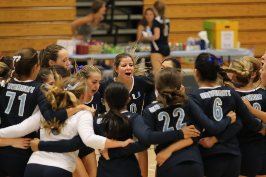 The team huddles after a victory (Charlene Huang)