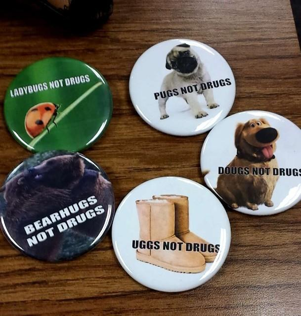 Pins were offered, promoting the fun alternatives of the theme,