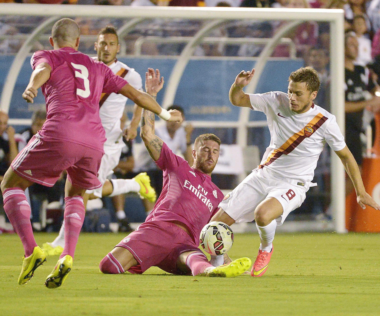 Real Madrid (in maroon) hopes to repeat last year's success (Max Faulkner/Fort Worth Star-Telegram/MCT)