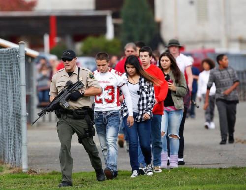 Students are evacuated after the shooting at Marysville Pilchuck High School in Marysville, Washington (Mark Harrison/The Seattle Times/MCT).