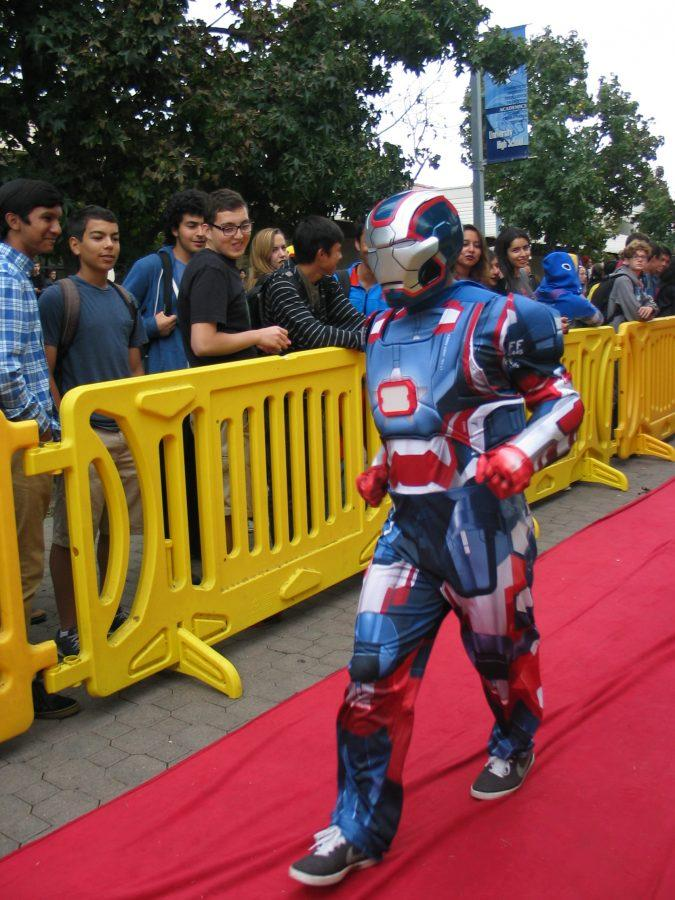 A student captures the Iron Patriot with his costume. (Nancy Wu)