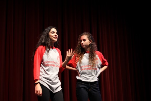 Alumna Layla Bina (2014) performs as a part of the red team.
