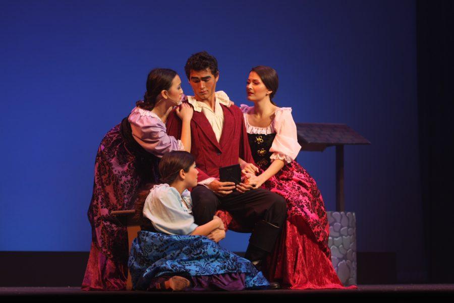 The Silly Girls Christine Ho (Jr.), Anabella Rangel-Sanchez (Sr.) and Keira Minuki (Sr.) drape themselves over Gaston, played by Austin Barber (Jr.).