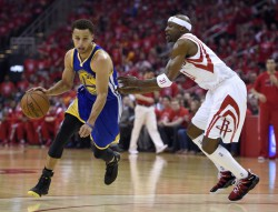 Golden State Warriors' Stephen Curry (30) dribbles against Houston Rockets' Jason Terry (31) during the first quarter of Game 4 of the NBA Western Conference finals. (Jose Carlos Fajardo/Bay Area News Group/TNS)