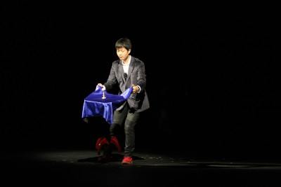 Rabby Yang (Jr.) performs a magic trick with a levitating table at the 2015 Talent Show. (Belana Beeck)