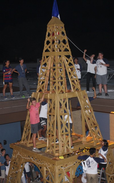 The seniors celebrate the final placement of the top portion of the Eiffel Tower while on the roof during Spirit Night. (Zoe Berger)