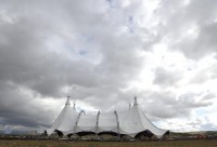 The tent, called The White Big Top, is being erected near the intersection of I-405 and SR-133 in Irvine for Odessa. The tent is 125 feet tall, higher than the Sleeping Beauty Castle in Disneyland which is 77 feet tall, and is about the size of a football field. The tent seats 2,000 people for the show, which combines  equestrian arts and high-tech theatrical effects in live performance. The White Big Top is the largest traveling tent in the world. ///ADDITIONAL INFORMATION: Slug: i.odesseo.0108.jag, Day: Thursday, January 7, 2016 (1/7/16), Time: 1:43:29 PM, Location:  Irvine, California - Odesseo - JEFF GRITCHEN, STAFF PHOTOGRAPHER