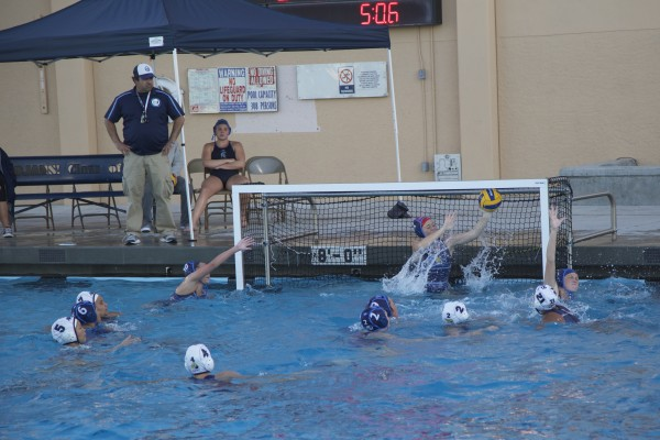 Goalie Molly Hudash (Sr.) reaches for one of her 12 saves against Northwood. (Alex Novakovic)
