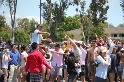 Seniors dance to music played by Gabe Kurtz (Sr.) in the senior lot for Frat day. (Zoe Berger)