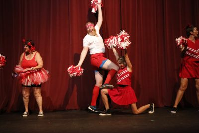 Teachers perform cheers as a parody of UHS students. (Danya Clein)