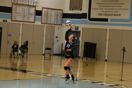 bella-oldham-sr-soars-into-the-air-and-slams-the-ball-across-the-net-starting-the-play