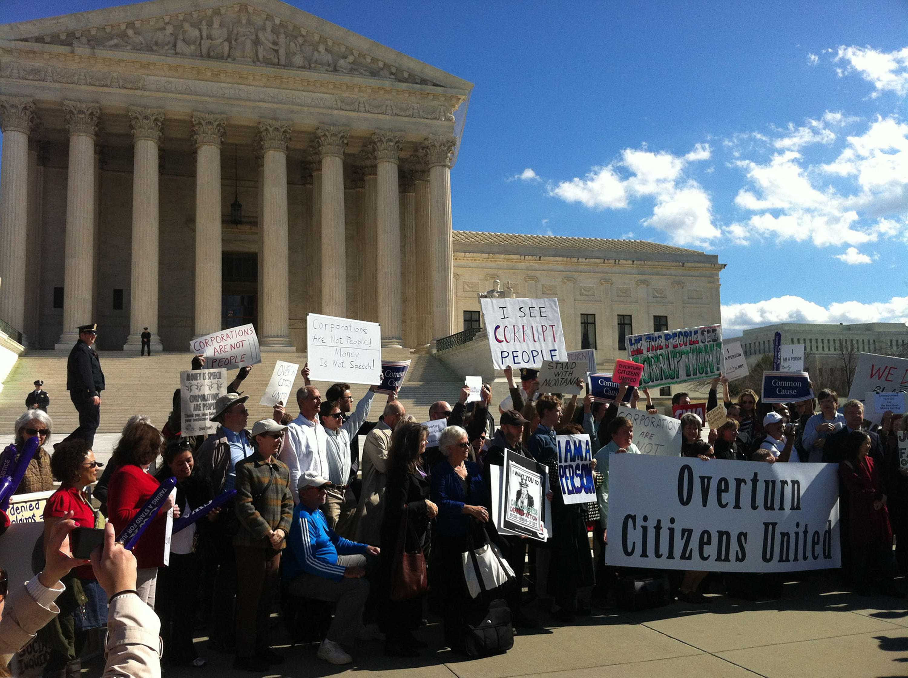 """Protesters outside the Supreme Court in 2012 rally against the court's decision in Citizens United, one of two rulings that has helped boost the influence of so-called """"dark money"""" groups in elections. (Photo by Jordan Krueger via flickr/Creative Commons/Cronkite News Service/TNS)"""