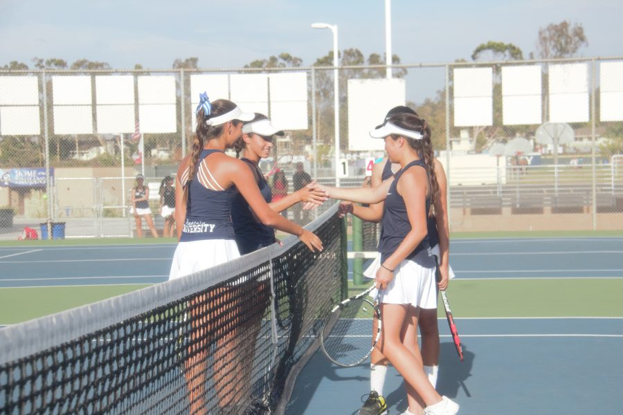 Co-Captain Sasha Iraniha (Jr.) and partner Kamar Alajeely (So.) shake hands with their Northwood opponents after a match. (I.Panis)