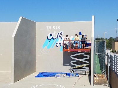 Three of the four artists (Jasmine Hsiao (Sr.), Asia Cowen (Sr.) and Anne Jang (Sr.)) working on the mural during the school day (Mr. D. Fratantaro)