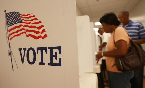 California voters cast their ballots for an election in their local area. (Photo by David McNew/Getty Images)
