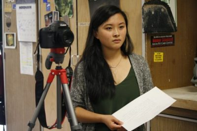 "Bethany Huang (Sr.) conducting an interview for her Video Production Project ""A Portrait of the Arts: Ceramics"" last year (Vicki Li)."