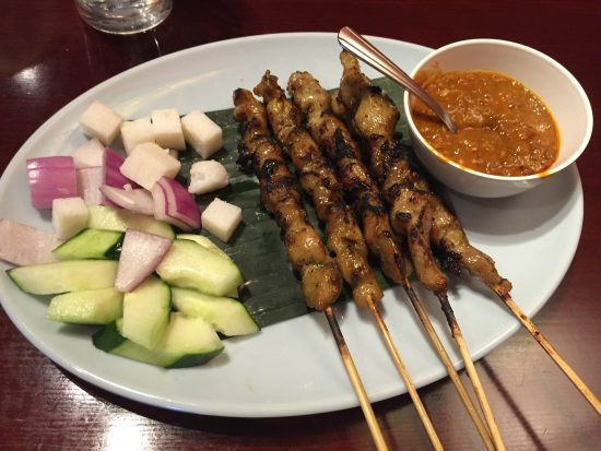 The Chicken Satay comes with a peanut sauce and cucumbers. (J. Lim Leong)