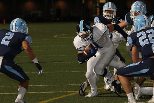 Farbod Memarian (Jr.) makes a tackle. (M.Chinn)