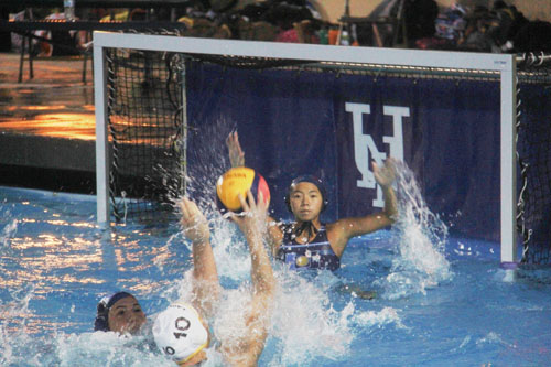 Goalie Anne Chen (Jr.) tries to block a shot by Laguna Hills opponent. (I.Panis)