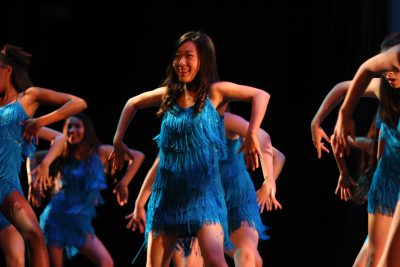 Nina Koh (Sr.) strikes a pose while dancing in UHS's number, Too Much to Bear (Victoria Yu).