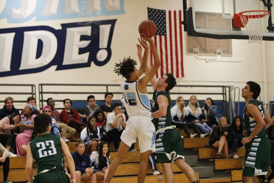 Alex Bray (Jr.) drives to the paint for a baseline jumpshot. (A. Iwata)