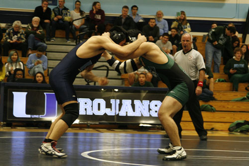 Ethan Chin (So.) goes head to head with his wrestling opponent. (R. Sabnis)