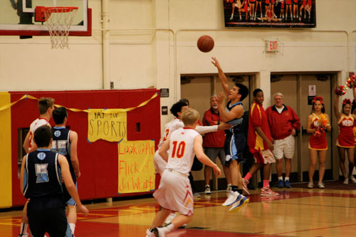 Point Guard Kevin Yahampath (Jr.) shoots a floater over a Woodbridge point guard. (A. Iwata)