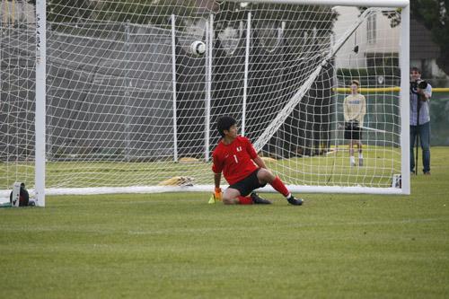 Goalie Jimmy Choi (Jr.) watches as penalty kick sails over goal. (J.Nagy)