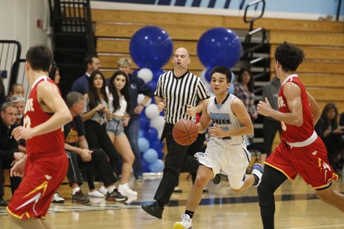 Kevin Yahampath (Jr.) pushes the ball up the court to set up a fastbreak. (A.Iwata)