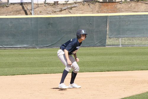 Kahi Rodrigues (Jr.) looks at the pitcher during practice in preparation to steal a base. (F.Duffy)