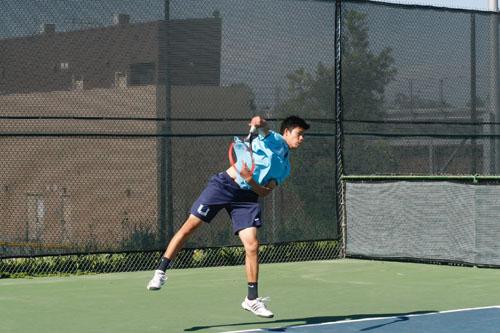 Naevin Anukornchaikul (Jr.) fires a strong serve against Northwood opponent. (V.Li)