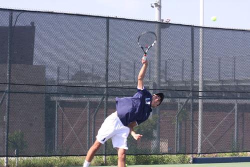 Julian LaFond (Jr.) hits a powerful serve to go for an ace (V.Li)