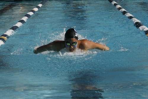 Erika Ervoes (Sr.) swimming the 100 butterfly, placing fourth. (J.Koo)