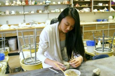 Ena Chen adds the final touches to her latest ceramics piece (Amanda Tran).
