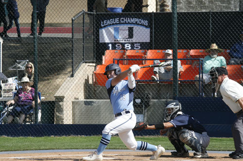 At bat, Nick Wetzel (So.) sends the ball flying. (A.Li)
