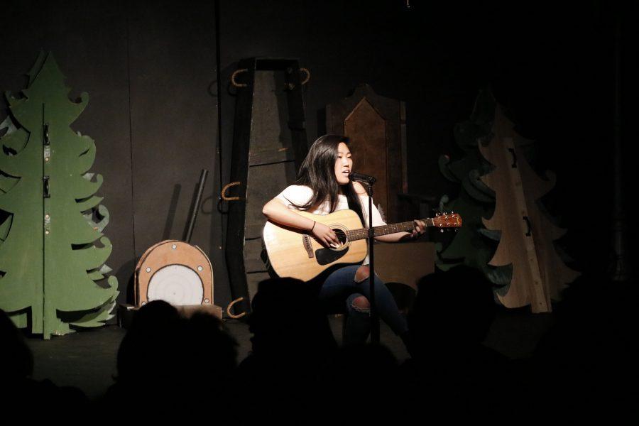 Kasey Kim (Sr.) sings onstage at Open Mic Night IX (Anne Iwata).