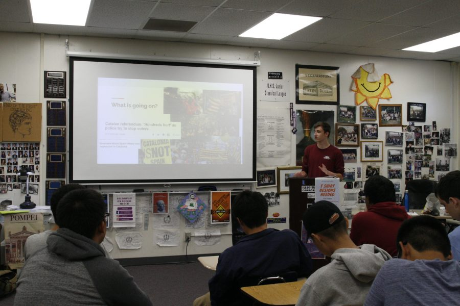 Michael Smith presenting his ideas to The History Club. (J. Huang)