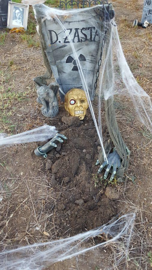Mrs. Valerie Thompson (Science Dept.) decorates her backyard every year with a graveyard theme. (Courtesy of Valerie Thompson)