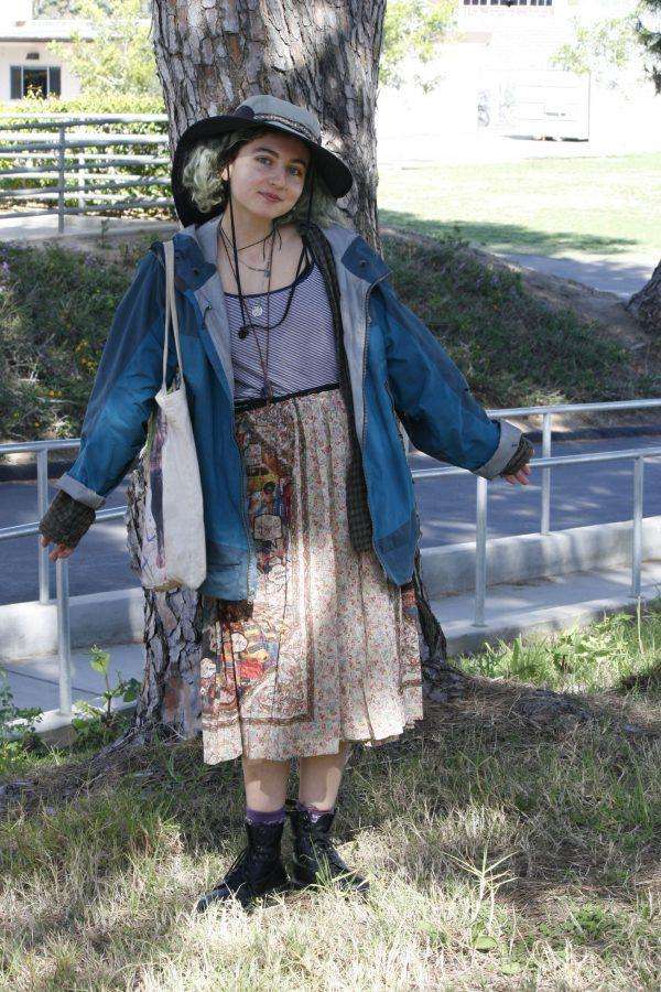Senior+Basileh+in+a+lovely%2C++floral+print+skirt%2C+grunge+plaid+shirt%2C+and+a+quirky+hat.++Her+style+is+down-to-earth+and+charming.+