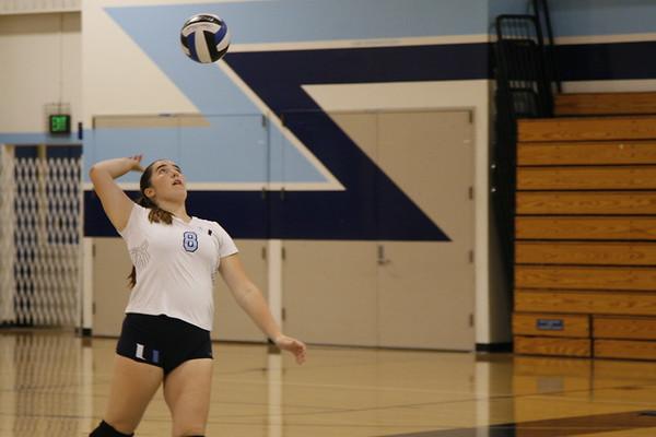 Junior Emma Stapp serves the ball. (C. Vang)