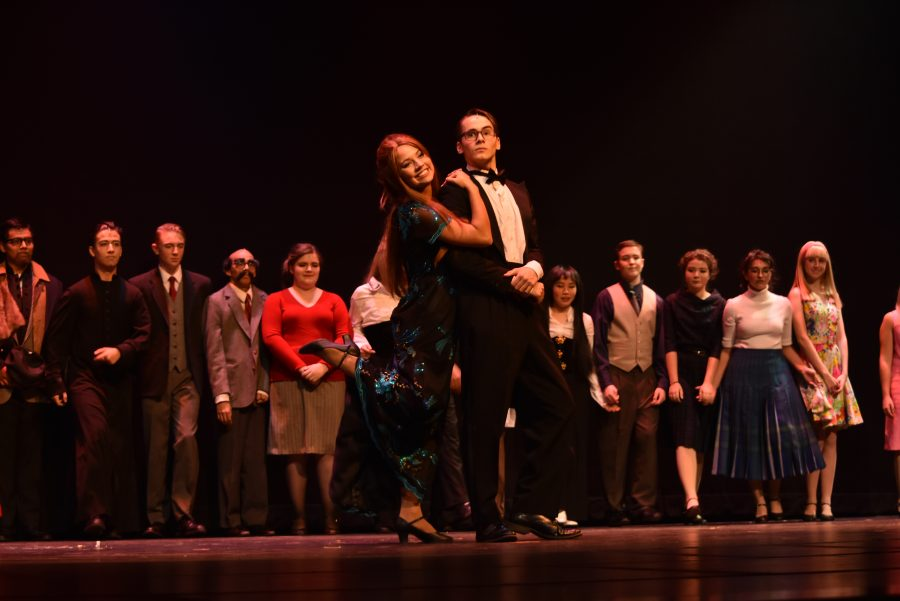Leads junior Davide Costa and senior Angelina Ross, with the rest of the cast, take bows at the finale (Claire Ke)