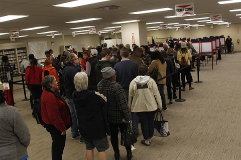 Voters stand in line inside of the  Board of Education on Nov. 2, 2018 to early vote in Cincinnati, Ohio.  (Ernest Coleman/Zuma Press/TNS)