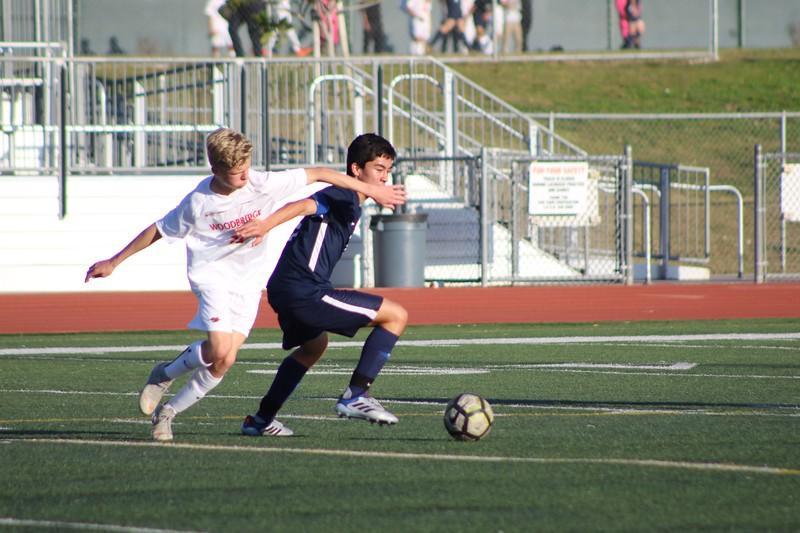 Senior Kyle Schaal battles for the ball against an opposing player. (J. So)