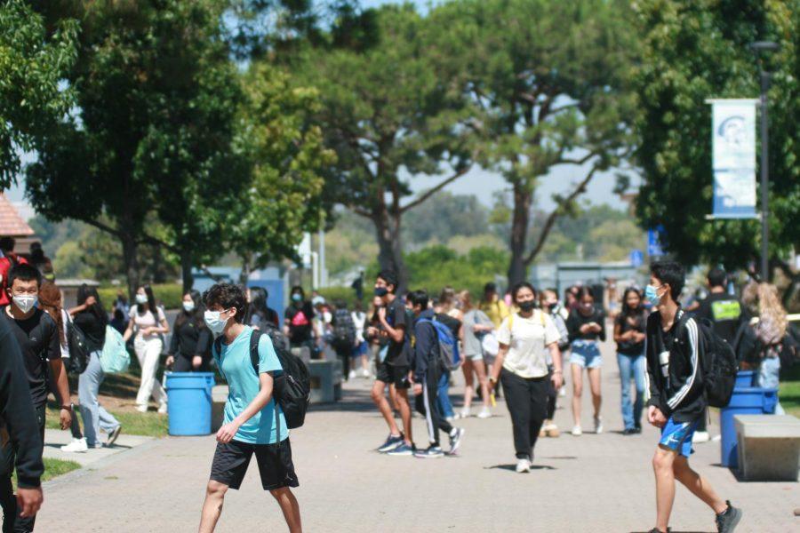 Students Walking Around Campus while practicing COVID Protocols at Max Capacity