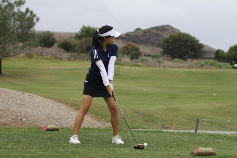 Freshmen Ally Kim preparing to swing.